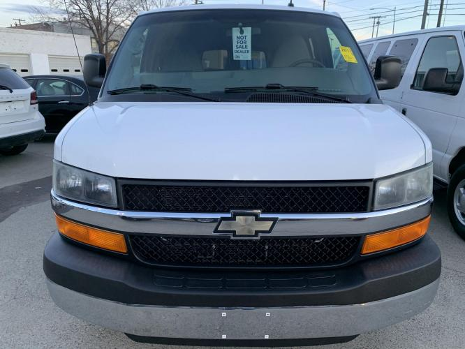2011 White /Gray Chevrolet Express Passenger LT (1GAZG1FG4B1) with an 8 Cylinder Engine engine, Transmission, 6-speed automatic, heavy-duty, electronically controlled with overdrive and tow/haul mode and internal transmission oil cooler (Standard on *G23406, *G33406 or *G33706 models. Includes external engine oil cooler. Reference the Engine/Axle pa transmission, located at 3200 1st Avenue North, Billings, MT, 59101, (406) 245-9055, 45.779270, -108.510742 - Photo #0