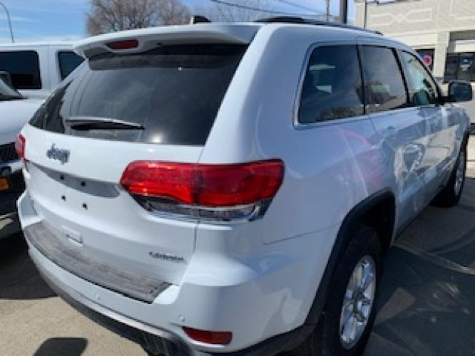 2019 White Jeep Grand Cherokee Laredo 4WD (1C4RJFAG2KC) with an 3.6L V6 DOHC 24V engine, 8A transmission, located at 3200 1st Avenue North, Billings, MT, 59101, (406) 245-9055, 45.779270, -108.510742 - Photo #3
