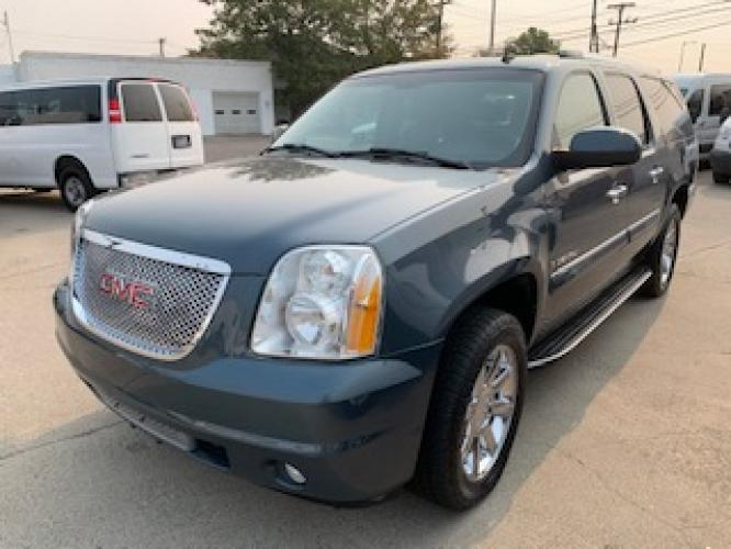 2007 Metallic Green /Charcoal Leather GMC Yukon Denali XL AWD (1GKFK66807J) with an 6.2L V8 OHV 16V engine, 4-Speed Automatic Overdrive transmission, located at 3200 1st Avenue North, Billings, MT, 59101, (406) 245-9055, 45.779270, -108.510742 - Photo #0