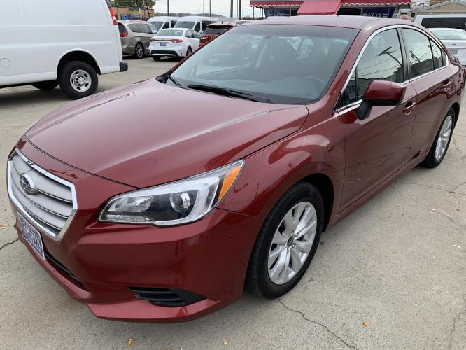 2017 Metallic Red /Charcoal Cloth Subaru Legacy 2.5i Premium (4S3BNAC62H3) with an 2.5L H4 SOHC 16V engine, CVT transmission, located at 3200 1st Avenue North, Billings, MT, 59101, (406) 245-9055, 45.779270, -108.510742 - Photo #0